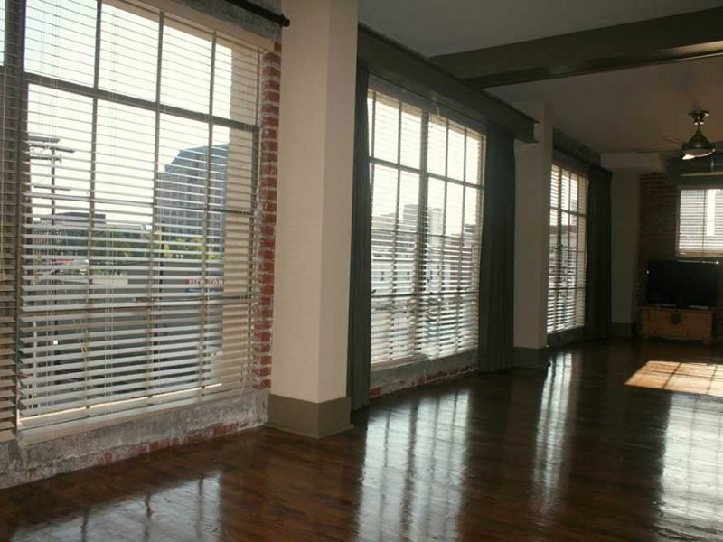 Big Lick Junction living room with large windows with view of the city