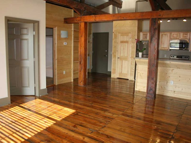 Big Lick Junction living room area with major wood beams and floors