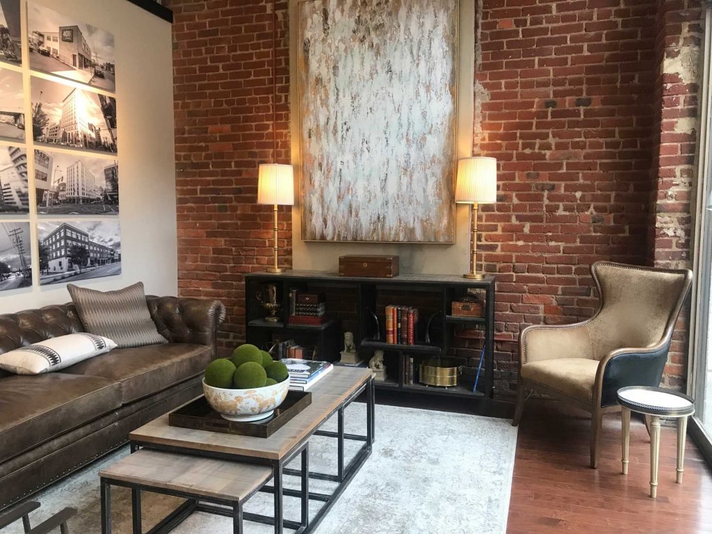 Allegheny Partners living room with sofa coffee table and art work hanging on the walls