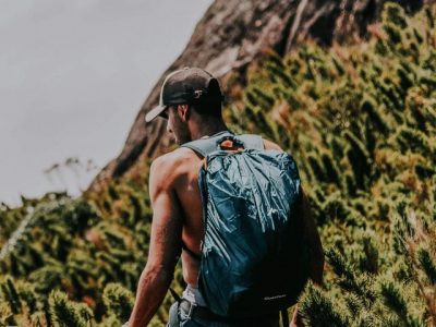 Man hiking with a backpack and hat