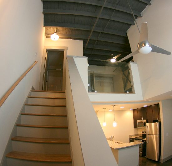 Auction House interior with stairs and kitchen