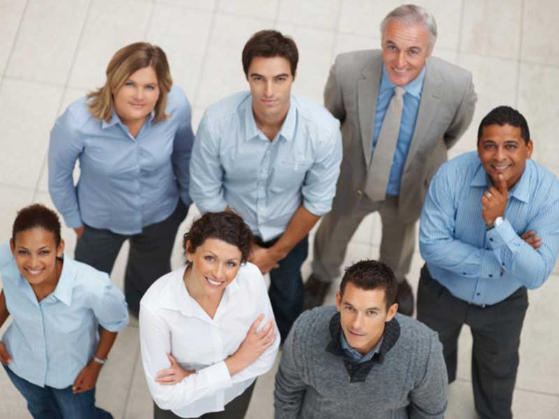 Group of Business People looking up towards camera