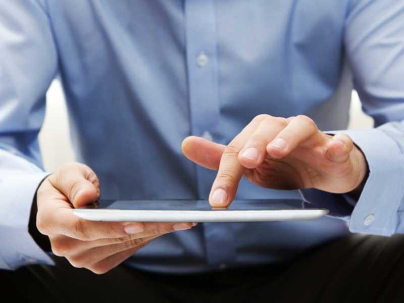 Man using an iPad